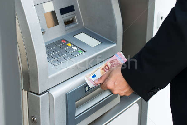 Person Withdrawing Money From Atm Machine Stock photo © AndreyPopov