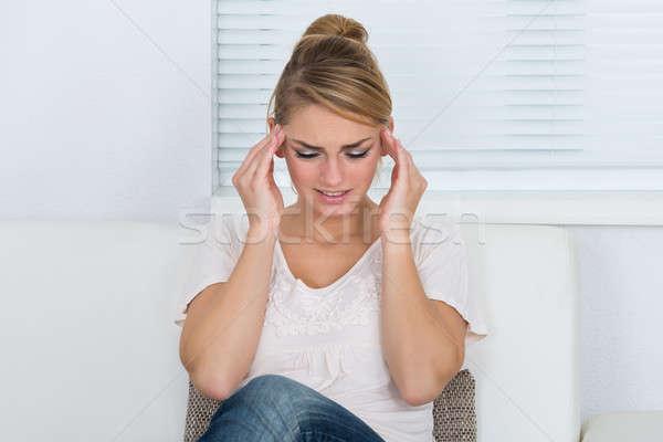 Mooie vrouw lijden hoofdpijn mooie jonge vrouw home Stockfoto © AndreyPopov