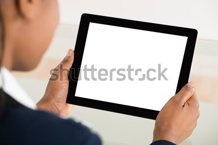 Businesswoman Holding Digital Tablet Stock photo © AndreyPopov