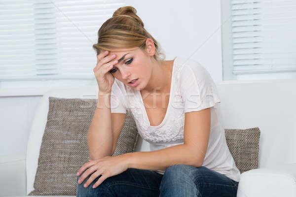 Vrouw hoofd lijden hoofdpijn jonge vrouw Stockfoto © AndreyPopov
