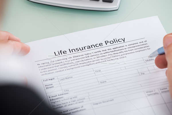 Person Filling Life Insurance Policy Form Stock photo © AndreyPopov