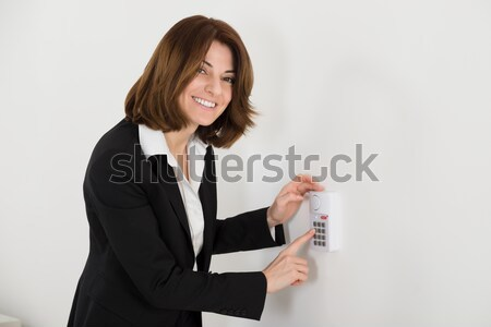 Woman Pressing Button On Security System Stock photo © AndreyPopov