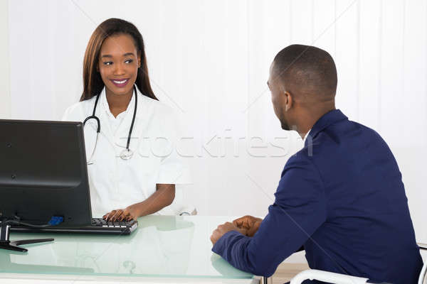 Doctor And Patient Discussing In Diagnostic Center Stock photo © AndreyPopov