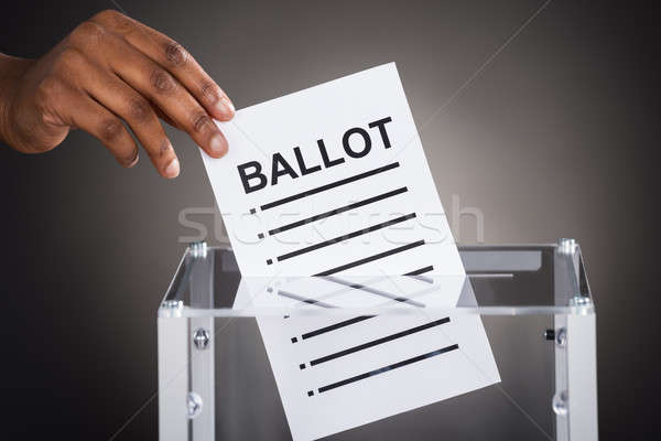 Person Hand Inserting Ballot In Box Stock photo © AndreyPopov