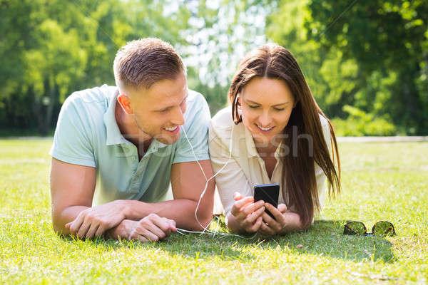 Couple Listening Music Through Mobile Phone Stock photo © AndreyPopov