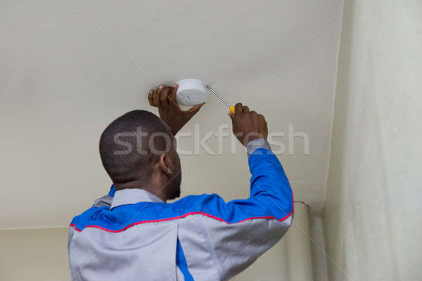Electrician Installing Fire Sensor Stock photo © AndreyPopov