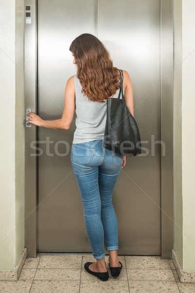Woman With Handbag Using Elevator Stock photo © AndreyPopov