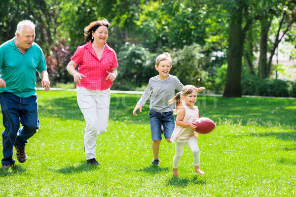Grandparent And Grandchildren Playing With Rugby Ball Stock photo © AndreyPopov