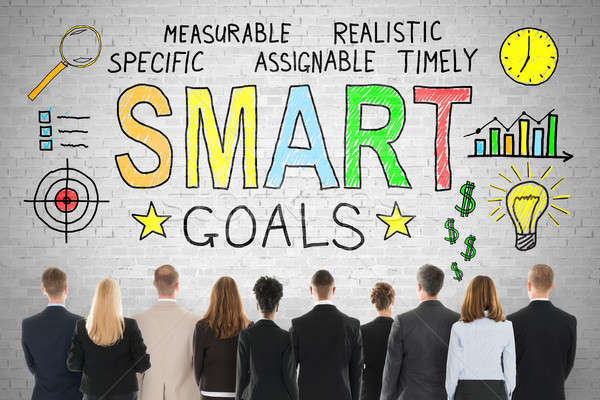 Businesspeople Looking At Smart Goals Concept On Wall Stock photo © AndreyPopov