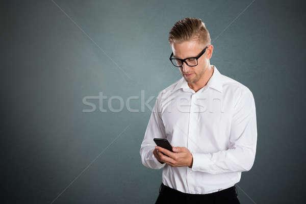 Imprenditore cellulare grigio telefono uomo tecnologia Foto d'archivio © AndreyPopov