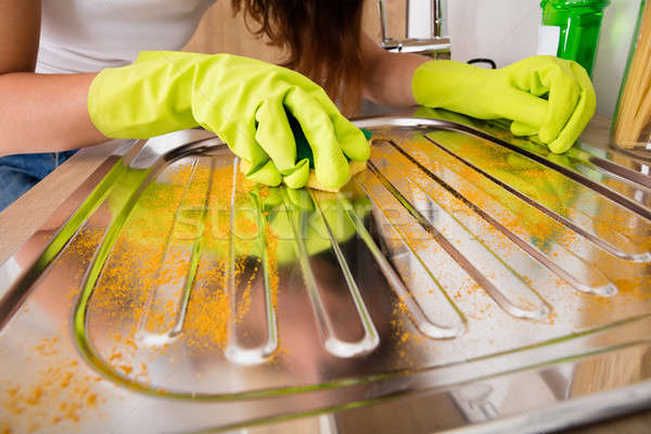Woman Cleaning Untidy Stainless Steel Sink Stock photo © AndreyPopov