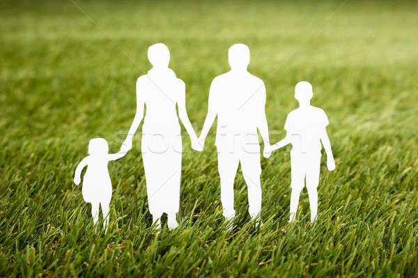 Family Papercut On Grassy Field Stock photo © AndreyPopov