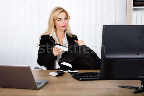 Businesswoman Stealing A Stapler Stock photo © AndreyPopov