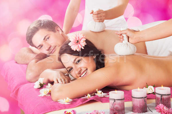 Young Couple Getting Massage In Spa Stock photo © AndreyPopov