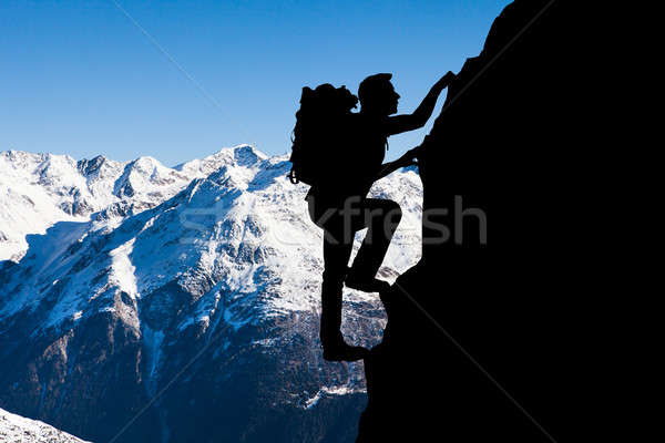 Man Climbing On Mountain Stock photo © AndreyPopov
