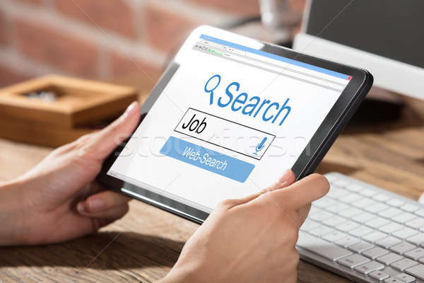 Person Searching Online Job Stock photo © AndreyPopov
