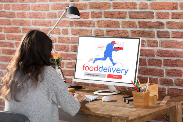 Woman Ordering Food Online Stock photo © AndreyPopov