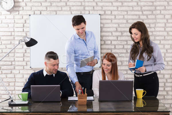 Happy Business People Doing Work At Workplace Stock photo © AndreyPopov