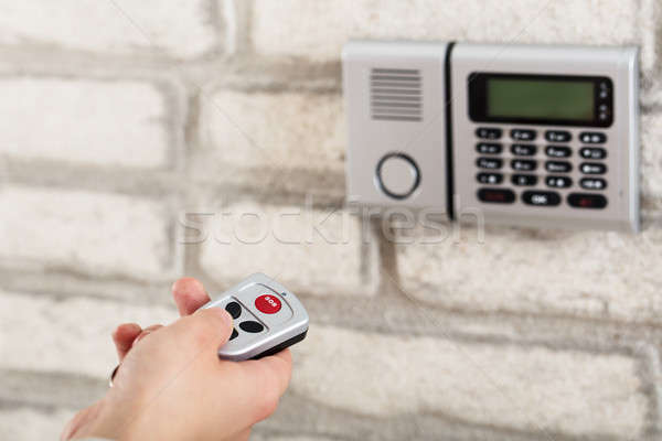 Hand Operating Door Security System With Remote Stock photo © AndreyPopov