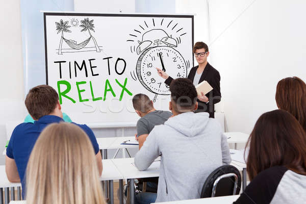 Teacher Giving Time To Relax Lecture Stock photo © AndreyPopov