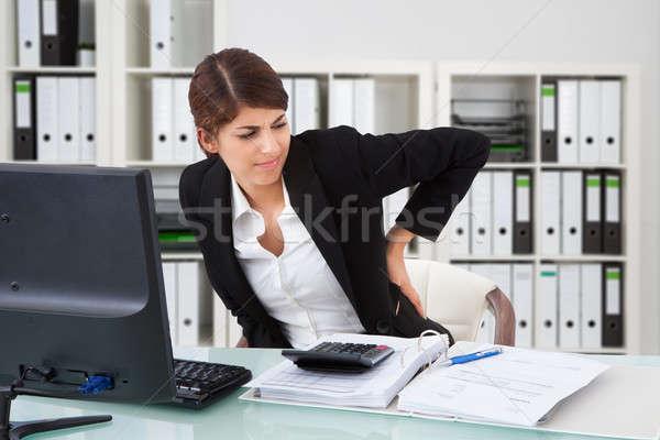 üzletasszony szenvedés hátfájás boldogtalan iroda számítógép Stock fotó © AndreyPopov