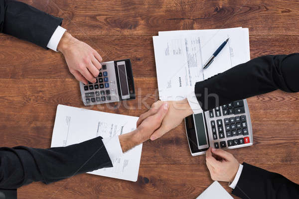 Elevated View Of Two Businesspeople Shaking Hands Stock photo © AndreyPopov