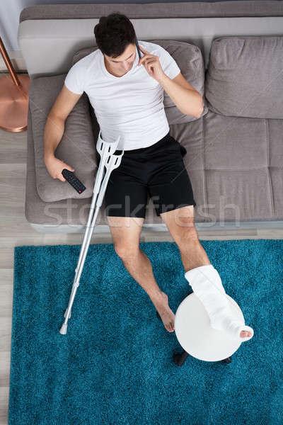 Сток-фото: раненый · человека · говорить · мобильного · телефона · мнение