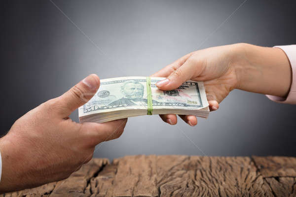 Stock photo: Businessperson Giving Bribe To Partner