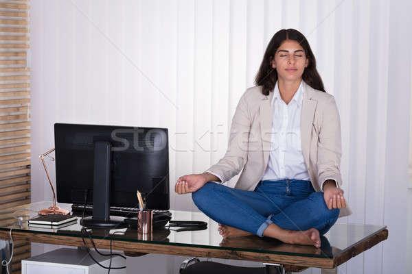 Női munkás meditál felső asztal fiatal Stock fotó © AndreyPopov