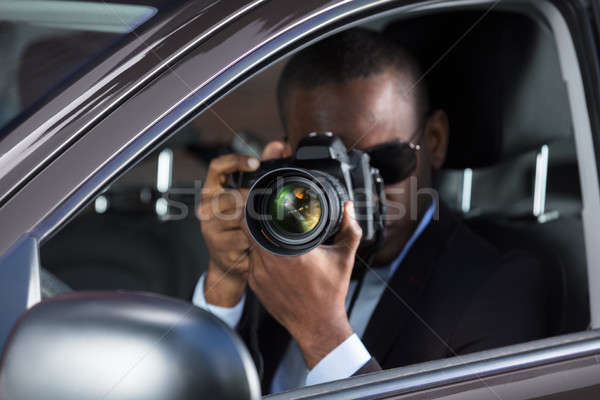 African Man With Camera Stock photo © AndreyPopov