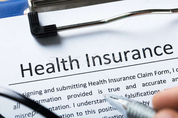 Stock photo: High Angle View Of Health Insurance Form