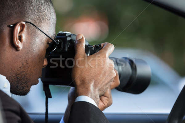 Private Detective Sitting Inside Car Photographing Stock photo © AndreyPopov