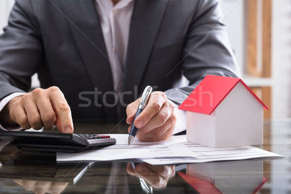 Businessperson Calculating Invoice With Calculator Stock photo © AndreyPopov