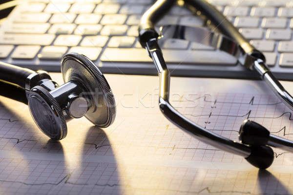 Sztetoszkóp elektrokardiogram közelkép asztal papír kórház Stock fotó © AndreyPopov