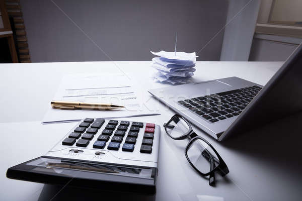 Documents With Calculator And Laptop Stock photo © AndreyPopov