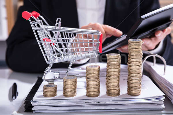 Stack Of Increasing Coins And Shopping Cart Stock photo © AndreyPopov