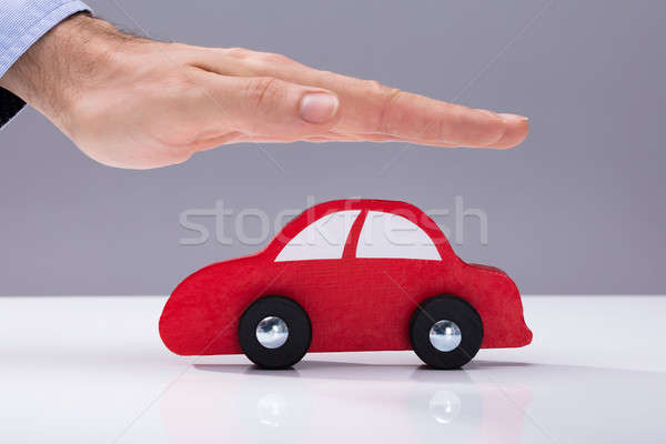 Human Hand Protecting Red Car Stock photo © AndreyPopov