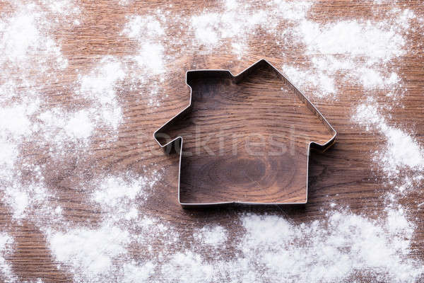 House Cutter On Wooden Desk Stock photo © AndreyPopov
