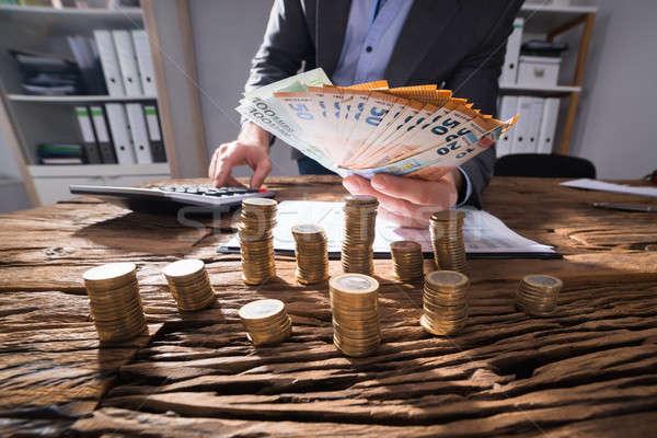 üzletember Euro bankjegyek egymásra pakolva arany érmék Stock fotó © AndreyPopov