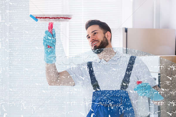 Janitor Cleaning Window With Squeegee Stock photo © AndreyPopov
