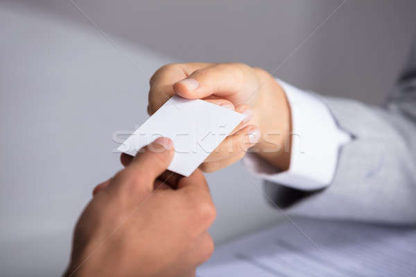Businessperson Giving Card To Partner Stock photo © AndreyPopov