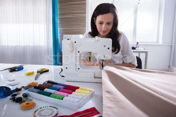 Fashion Designer Stitching Fabric On Sewing Machine Stock photo © AndreyPopov