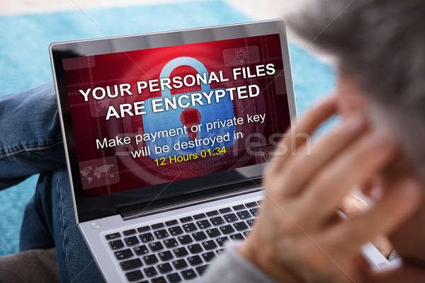 Személy néz laptop képernyő közelkép mutat Stock fotó © AndreyPopov