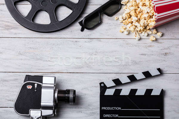 Spilled Popcorn With Clapperboard And Movie Camera Stock photo © AndreyPopov