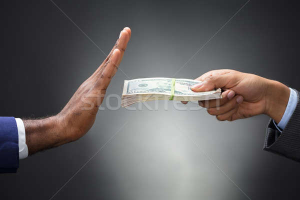 Close-up Of A Man's Hand Refusing Bribe Stock photo © AndreyPopov