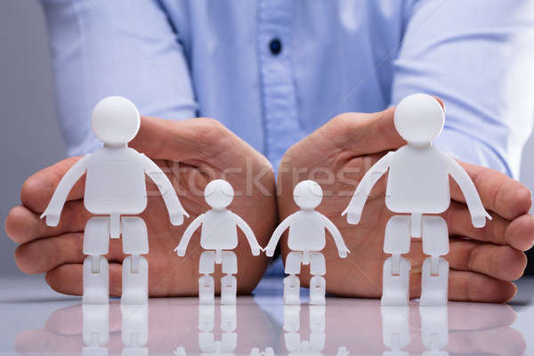 Person Protecting Family Human Figures Stock photo © AndreyPopov