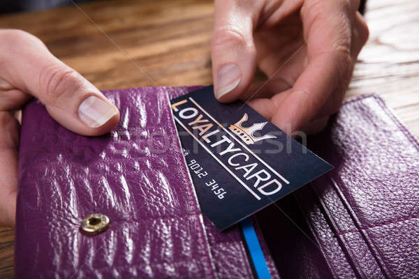 Businessperson Removing Loyalty Card From Purse Stock photo © AndreyPopov