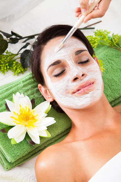 Beautiful Woman With Facial Mask At Spa Stock photo © AndreyPopov