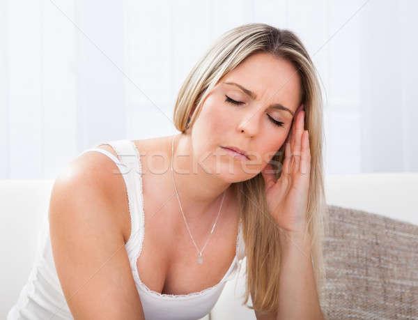 Portrait of woman with migraine Stock photo © AndreyPopov