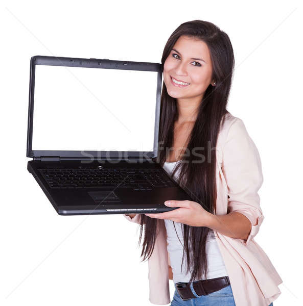 Woman holding a blank laptop Stock photo © AndreyPopov